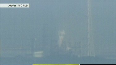 News footage by Japanese public broadcaster NHK shows white smoke rising from the Fukushima No. 1 nuclear power station number three reactor after what reports described as a hydrogen explosion.