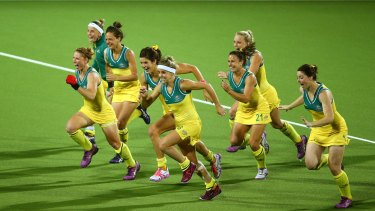 Celebration time: the Hockeyroos jubilant after Madonna Blyth scores the winning goal.