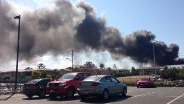 Smoke billows from the honey factory fire. Photo: Ellen Gray.