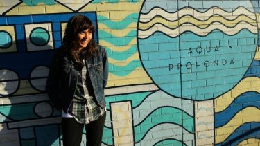 Courtney Barnett in front of the Aqua Profunda sign at the Fitzroy Pool.