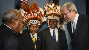 """Prime Minister Kevin Rudd and his PNG counterpart  Sir Michael Somare  with """"Fuzzy Wuzzy Angels"""" Dickson Hango and Wesley Akove in Canberra yesterday."""