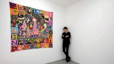 Melbourne artist Paul Yore with a piece from his latest show, <i>Fountain of Knowledge</i>.
