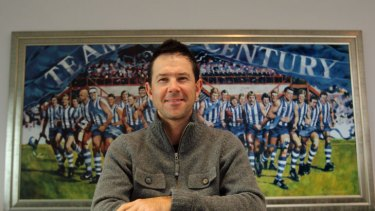 Still having a ball ... Ricky Ponting pictured in the boardroom of the North Melbourne AFL club, where he is the club's No.1 ticket holder.