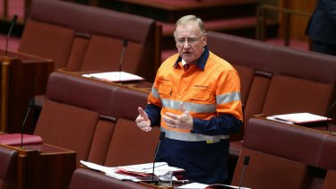 Liberal Senator Ian Macdonald speaks on the mining tax repeal. Photo: Alex Ellinghausen