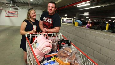 Trolley full: Even the dog gets a treat when Clare Lavery and Chris Mennen make their monthly trip to Costco at Lidcombe.