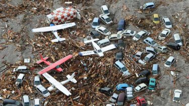 Sendai airport was awash with light planes, vehicles and the remains of houses and other buildings after the tsunami swept through the region.