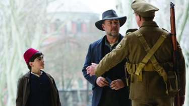 Joshua Connor (Russel Crowe) and Orhan (Dylan Georgiades) in a scene from The Water Diviner.