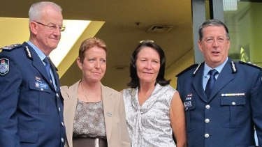 Outgoing police commissioner Bob Atkinson, with his partner Glenda, and his relacement Ian Stewart, with wife his Carol.