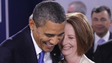 A laugh and a joke ... US President Barack Obama greets Australia Prime Minister Julia Gillard.