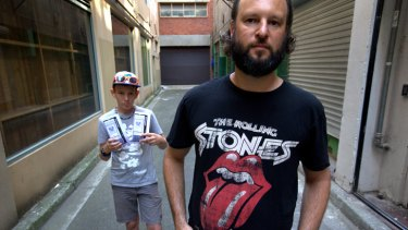Justin Quintner, right, and his 13-year-old son Andre travelled from Darwin via Adelaide to see the Rolling Stones at Hanging Rock.