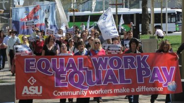 Long march ... community workers rally for equal pay in Canberra last September.