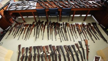 Police seized about 150 guns from a Mt Morgan property in central Queensland.