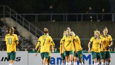 Two's company: Michelle Heyman (third from right) celebrates scoring the Matildas' second goal in the 3-1 win over Japan.