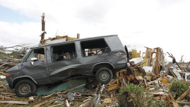 Residents search through what is left of their homes after a tornado hit Pleasant Grove.