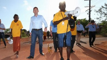 Prime Minister Tony Abbott joins school attendance officers on the walking bus in Yirrkala during his visit to North East Arnhem Land on Wednesday.