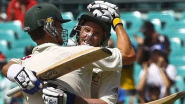 """Tainted"" performances ... Mike Hussey gets a hug from Peter Siddle after completing his century at the SCG against Pakistan"