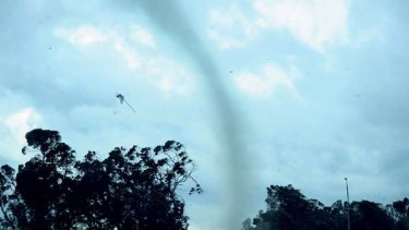 A road sign flies through the air as a tornado hits Moama. <i>Picture: Jenna Natalizio</i>