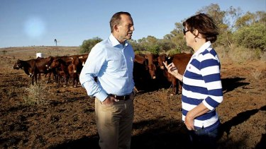 "Prime Minister Tony Abbott met grazier Kym Cramp of ""Mount Gipps"" station near Broken Hill, NSW, as part of a drought tour with Agriculture Minister Barnaby Joyce on Monday."