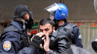 Turkish police arrest a Kurdish man during a demonstration in the main Kurdish city Diyarbakir.