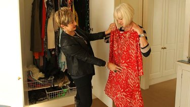 Suzy Black, Personal Shopper and Stylist giving client Carol Turner, 53 a wardrobe make-over in her home.