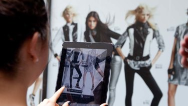 Now you see it ... customers in Sydney shop the Karl range by Karl Lagerfeld using Net-a-Porter's Live app.