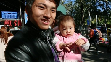 """Ma Qingtian, with his one-year-old daughter, says it would be  """"wonderful"""" to have a second child but financial pressures make it unrealistic."""