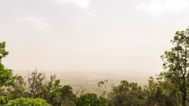 Dust settles over Canberra after strong winds bring particles from western NSW.