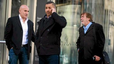 John Elias (far left), Kamal Tamer and George Grotta outside Melbourne County Court on Wednesday.