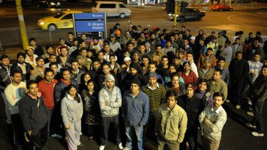 Safety in numbers: Indian students and workers gather outside St Albans station to help late-night commuters avoid attacks.