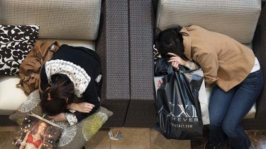 Black Friday shoppers take a rest at Westfield Galleria in Sacramento, California.