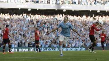 Samir Nasri celebrates a goal for Manchester City.