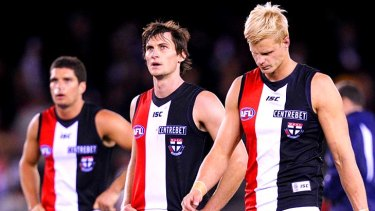 St.Kilda's Leigh Montagna, Farren Ray and Nick Riewoldt after losing to Essendon.