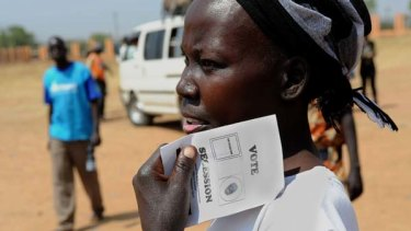 A woman holds a ballot paper to be used in the referendum.