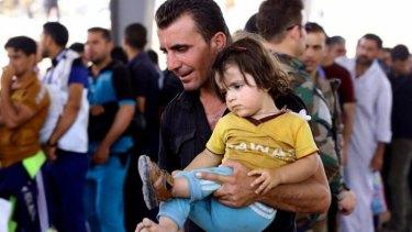 Refugees fleeing  Mosul head to the self-ruled northern Kurdish region in Irbil.
