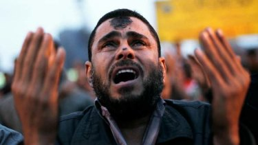 An Egyptian protester cries during prayers in Tahrir Square in Cairo.