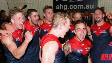 Friend like Ben: Ben Kennedy (inner right) enjoys his first rendition of the Melbourne song.