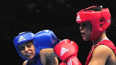Quanitta Underwood fights Natasha Jonas of Great Britain in the Olympic test event in London last November.