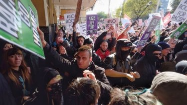 Police clash with protesters on Saturday in Melbourne.