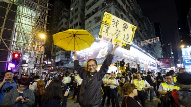 "A pro-democracy protester shows a sign saying, ""I want true universal suffrage"", during demonstrations in Hong Kong in November 2014."