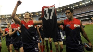 Melbourne's captain James McDonald and Aaron Davey pay tribute to the jumper of ailing club president Jim Stynes in 2009. Davey is tipped by many to become the next Melbourne captain.