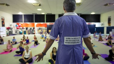 Teacher Robyn Sawatzky leading a yoga class in a dress. An exercise that has helped raise thousands for charity.
