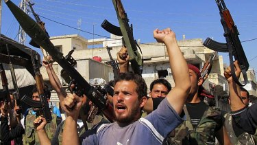 Members of the Free Syrian Army (pictured at a rally) say more regime soldiers have defected.