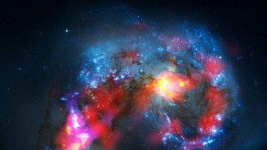 This image shows the  Antennae Galaxies as a pair of distorted colliding spiral galaxies, combining Atacama large milllimetre/submillimetre array (ALMA) observations.