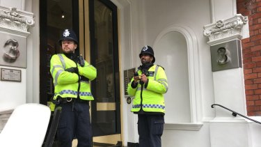 Police outside the Ecuadorian embassy on Monday.