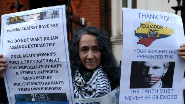 A protester outside the Ecuadorian embassy in London on Thursday.