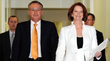Winners are grinners ... Wayne Swan and Julia Gillard arrive to deliver their victory speech.