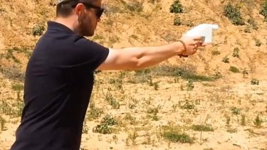 """""""There's a lot of work to be done"""": Liberator inventor Cody Wilson tests the gun."""