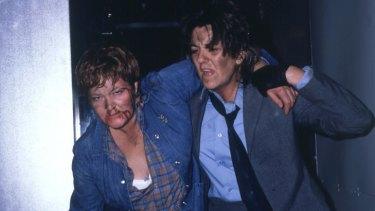 Bea (Val Lehman) and The Freak (Maggie Kirkpatrick) flee a fire in Prisoner.