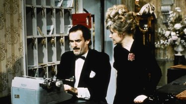 John Cleese and Prunella Scales in a scene from <i>Fawlty Towers</i>.