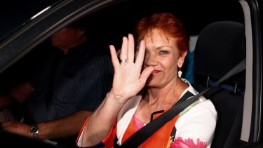 Pauline Hanson is driven away from the event.